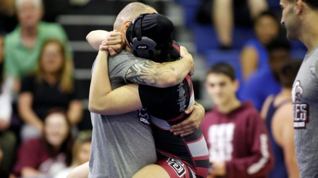 Stoneman Douglas wrestlers mourn their coach, then wrestle in his memory